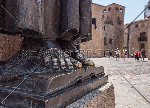 Caceres, Spain - july 13, 2018: Monument to San Pedro de Alcantara, made in 1954, located in the Plaza de Santa Maria, annexed to the church, Caceres, Spain