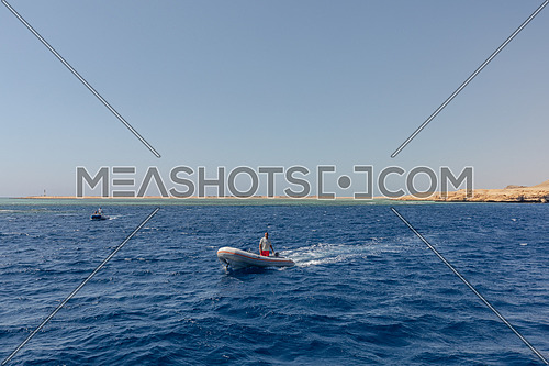 Long shot for Zodiac (Inflatable boat) sails in The Red Sea by day