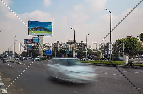Fixed Left for traffic at Salah Salim Street showing AL Galaa Bridge in background at Daytime