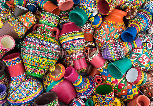 Pile of artistic painted handcrafted pottery jars (arabic: Kolla)