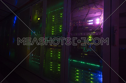 panel modern communication equipment with light from the display at data center in the server room