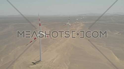 Drone shot of windmills on a windy day by the coast of the red sea