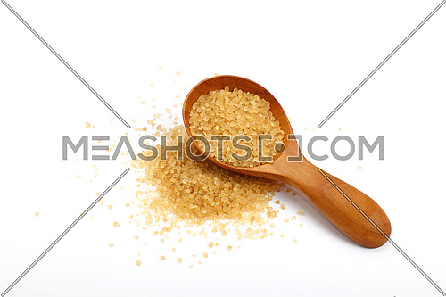 Wooden scoop spoon of brown cane sugar with pinch of sugar spilled around isolated on white background, high angle view