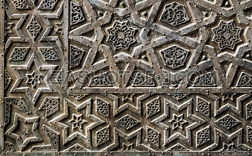 Ornaments of the bronze-plate ornate door of Sultan Qalawun mosque, an ancient historic mosque in Old Cairo, Egypt
