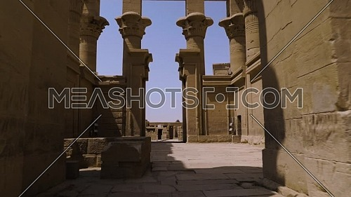 Track in shot inside the temple of Phila at Aswan - Egypt by day