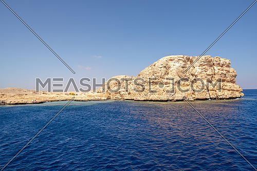 Long shot from Red Sea showing Ras Muhammed Island by day