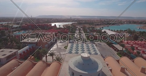 Aerial Reveal shot flying above Sheraton Miramar Hotel in Al Gouna at Day