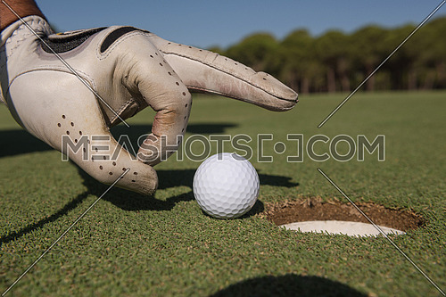 golfer hand with ball