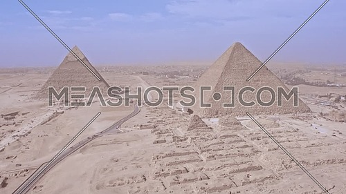 Fly over Shot Drone for The Great Pyramids of Giza then focus on The Pyramid of Khufu in giza at day