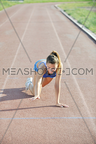 young woman finaly passing finis line at athletics running race track