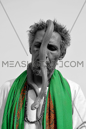 An african man with a snake around his head