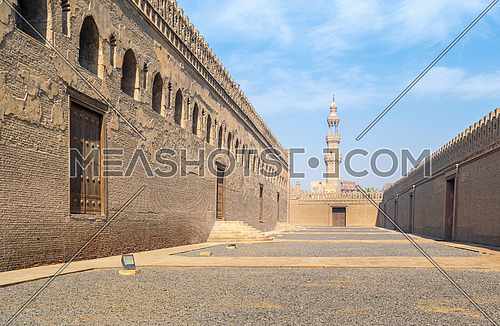Passages surrounding Ibn Tulun mosque with minaret of Amir Sarghatmish mosque at far distance, Sayyida Zaynab district, Medieval Cairo, Egypt