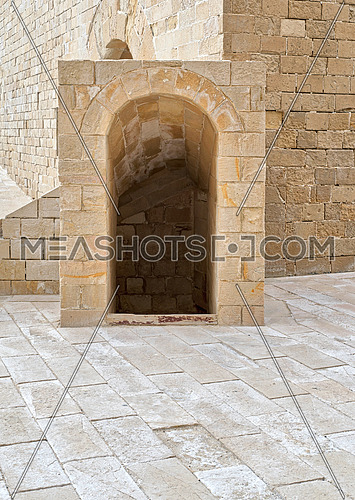 Ancient crypt entrance, bricks stone wall and tiled stone floor beside Kayet bay castle, Alexandria, Egypt