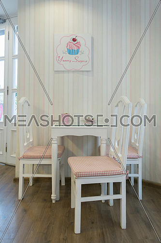 interior decoration a white dining table with three chairs