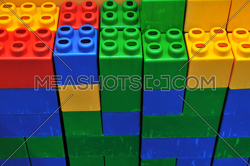 colorful brick toy background in child playground