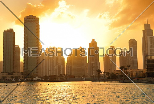 dubai city skyline at sunset conctruction and modern architecture concept