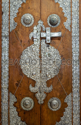 Wooden door decorated with silver plating ornaments from Sayeda Zaynap Mosque, Old Cairo, Egypt