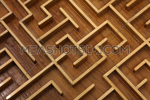 Close up of brown wooden labyrinth maze, toy puzzle game, elevated high angle view