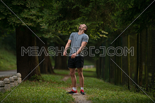Portrait Of Young Man Doing Outdoor Activity Running - Laughing