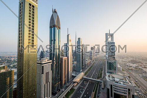 Long shot for Dubai City showing skyscrapers and traffic at day.