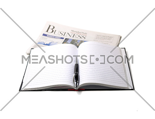newspaper,pen and notebook on white background