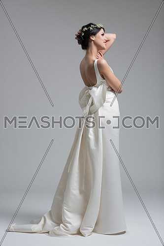 Portrait of beautiful young women in wedding dress isolated on a white background