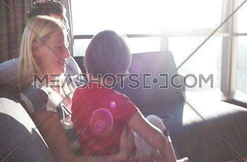 Family having fun at home with sun rays coming from window