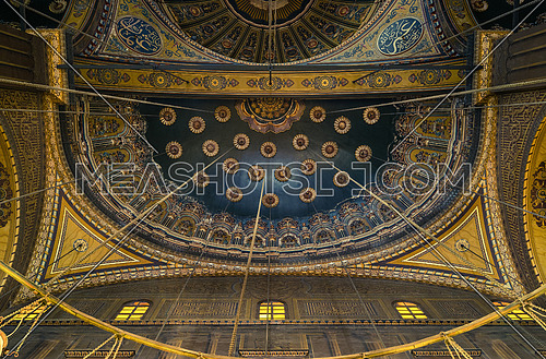 Part of Mohamed Ali Mosque ceiling with the lights hangging wires form leading lines.