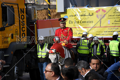 Mid shot for a Ceremony Solider riding a horse surrounded by engineers and security at the Ramses II Statue transferring to The Grand Egyptian Museum Event in Cairo on 25 January 2018