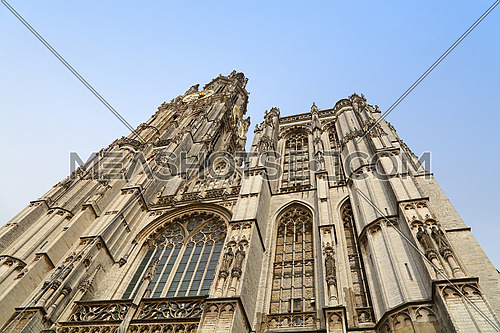 Medieval gothic cathedral of Our Lady in Antwerp, Belgium over clear blue sky, low angle front view