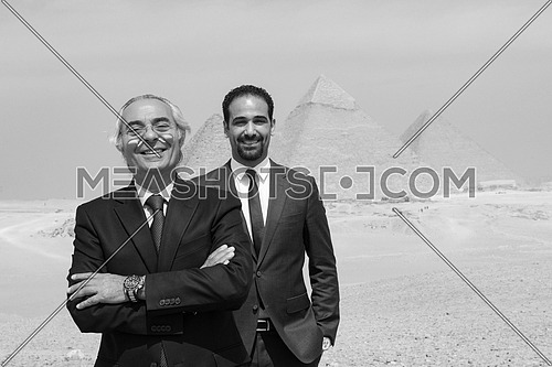 successful arab business people at Egyptian giza plateu with pyramids in backgronud