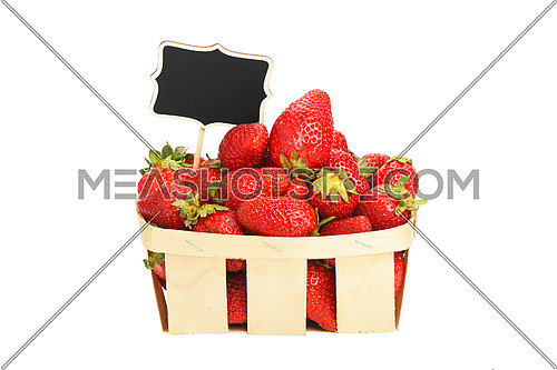 Strawberry in wooden basket with price sign