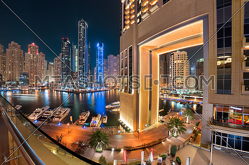 Dubai Marina Towers with a beautiful Giant Gate Building on the right side, and colorful reflections on water