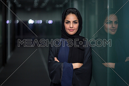Saudi lady standing and smiling