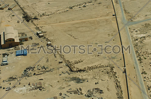 Arial shot for road in the desert to a storage yar in Suez at day