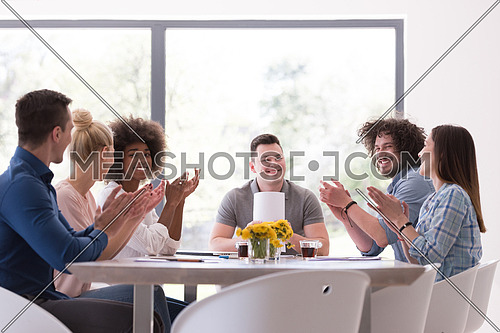 multiethnic Group of young business people  looking happy while celebrating success at their working places in startup office