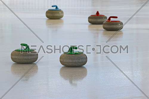 Curling stones standing still on the ice during a game