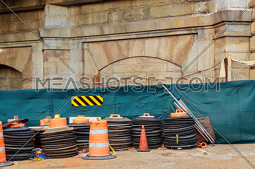 Construction zone with orange caution markers along an urban street. road works