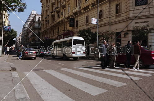 Fixed low angel Shot for Traffic at Talat Harb Street at Cairo at Day