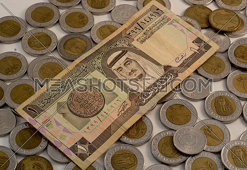 one Riyal with one egyptian pound coins