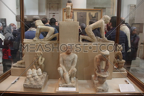 a photo from inside the Egyptian museum showing a pharaoh monumental statues during ancient Egypt civilization