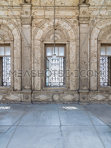 Three adjacent arched windows with decorated iron grid over white marble decorated wall at the Mosque of Muhammad Ali Pasha (Alabaster Mosque), Citadel of Cairo, Egypt
