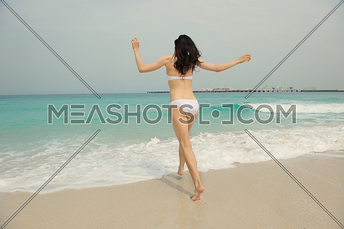 Happy Beautiful Woman Enjoying Summer Vacation on beach