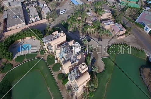 Drone shot flying above a House and a golf course Al Gouna at Day