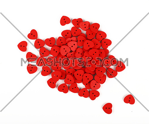 Red heart shaped handmade wooden sewing buttons isolated on white, close up, elevated top view