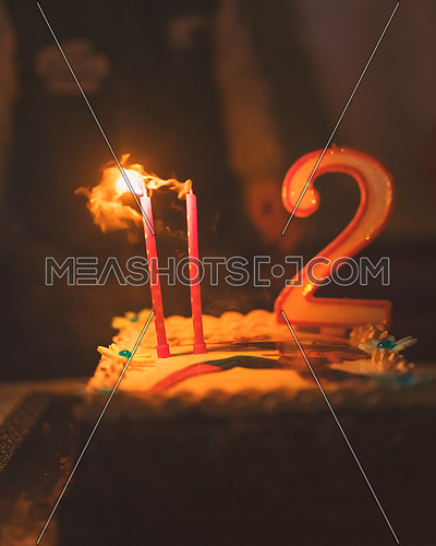 Happy birthday cake with two candles, low depth of focus for dreaming atmosphere used split toning.