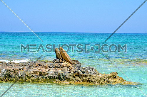 Rocks on little island in the mediterranean sea (a state of peace of mind) , North Coast - Egypt at day.