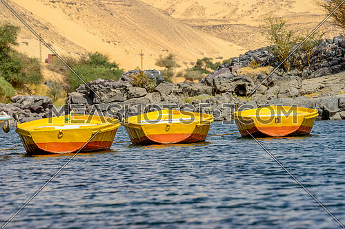 Close up for three Felluca's anchoring in the river nile at Aswan at day
