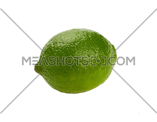 Close up one whole fresh green lime fruit isolated on white background, low angle side view