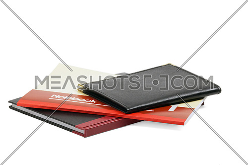 assorted notebooks flat piled on white background